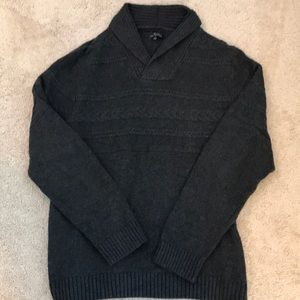 Men's charcoal shawl neck sweater.